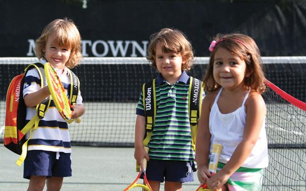 kids enjoying doing tennis activities after school